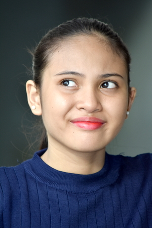 Smirking Filipina Female Stock Photo - 109690493