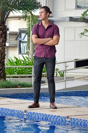 Unemotional Diverse Male Man Standing By Pool Stock Photo