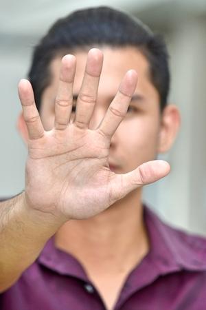 Minority Male Gesturing Stop