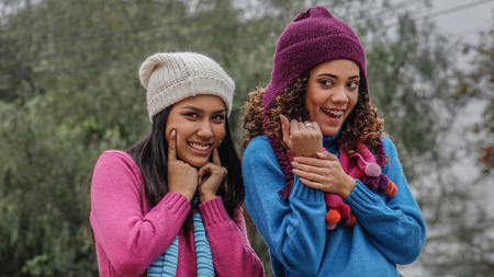 Hispanic Female Friends In Cold Weather