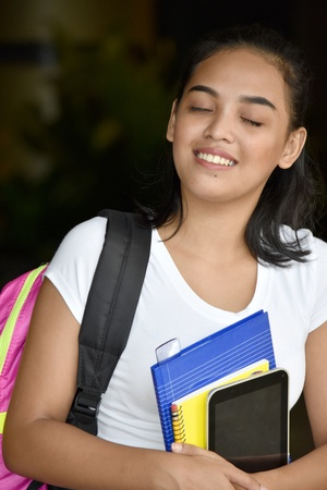 Happy Cute Minority Girl Student With Books