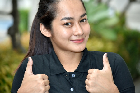 Cute Filipina Teen Girl With Thumbs Up Stock Photo