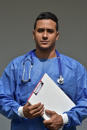 Serious Intelligent Person Wearing Scrubs With Clipboard Stock fotó