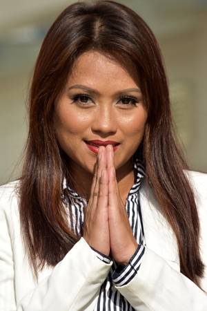 Business Woman In Prayer Wearing Suit