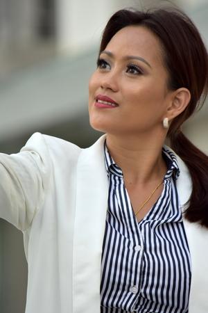 Portrait Of A Smart Filipina Person Wearing Suit