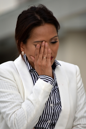 Unhappy Attractive Asian Business Woman Wearing Suit