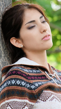 Pretty Latina Female With Eyes Closed Stock fotó