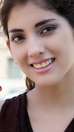Smiling Young Latina Female Фото со стока