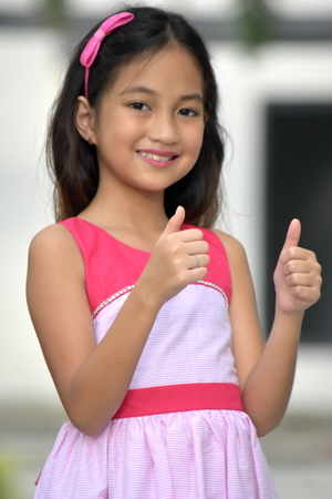 Cute Filipina Female With Thumbs Up