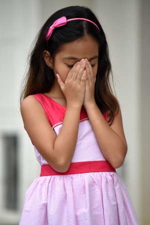 Filipina Teenage Female And Sadness Wearing Dress Stock Photo - 111260269