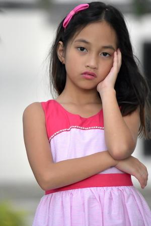 Worried Beautiful Filipina Person Wearing Dress Stock Photo