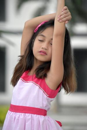 Stretching Youthful Filipina Girl