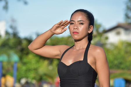 Adult Female Saluting
