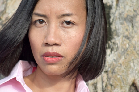 Unemotional Filipina Female Stock Photo