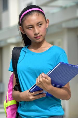 Serious Pretty Filipina Person With Books