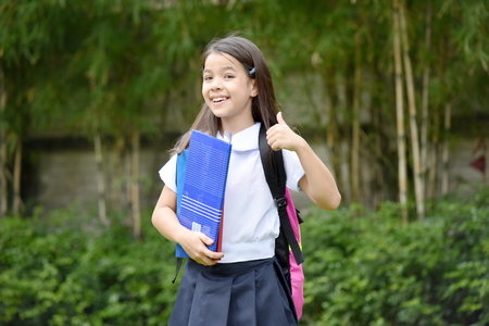 Happy Catholic Minority Female Student With Notebooks