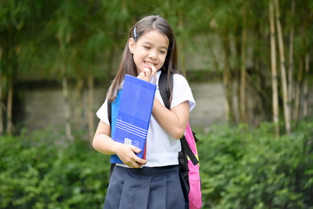 Shy Female Student With Notebooks Stock Photo