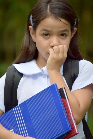 Minority Female Student And Fear Wearing School Uniform