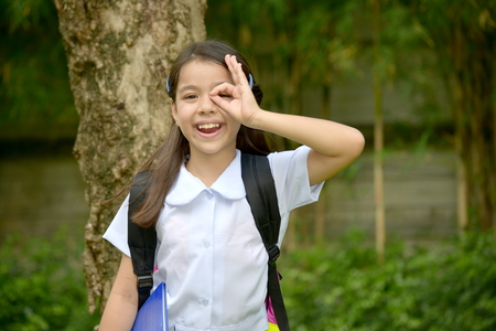 Minority Child Girl Student Searching Wearing School Uniform With Notebooks 写真素材