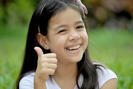Minority Female With Thumbs Up Фото со стока