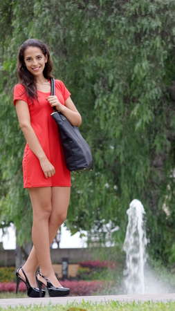 Stylish Young Diverse Person Wearing A Red Dress