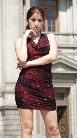 Hispanic Adult Female Thinking Wearing Dress Standing Banco de Imagens