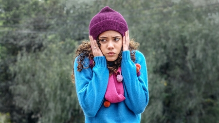 Teenager Girl In Cold Weather Wearing Sweater And Scarf Stock Photo