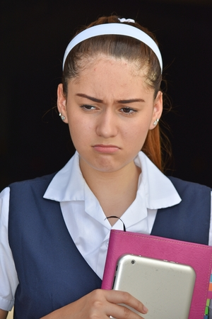 Unhappy Colombian Person Wearing School Uniform With Books