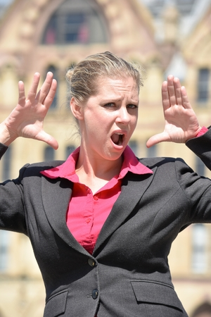 Shocked Adult Blonde Business Woman Wearing Suit