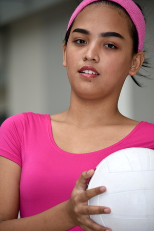 Serious Diverse Female Athlete With Volleyball Фото со стока