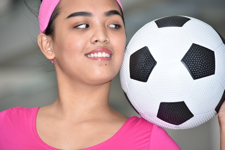 Fit Asian Female Athlete And Happiness With Soccer Ball Stock Photo