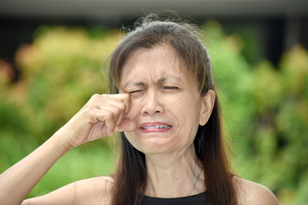 Tearful Old Asian Female Senior