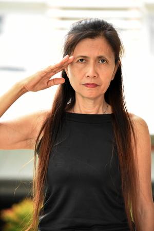 Old Female Senior Saluting