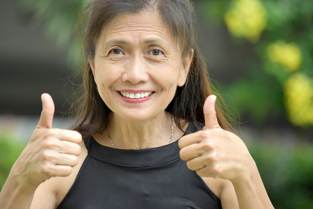 Grandmother With Thumbs Up Stock Photo