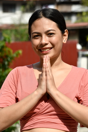 Youthful Asian Female Praying
