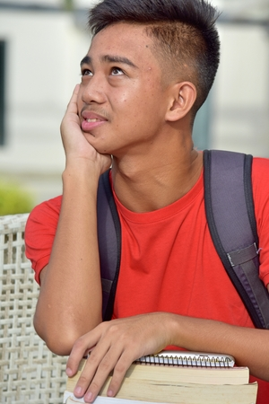 Contemplative Male Student 스톡 콘텐츠