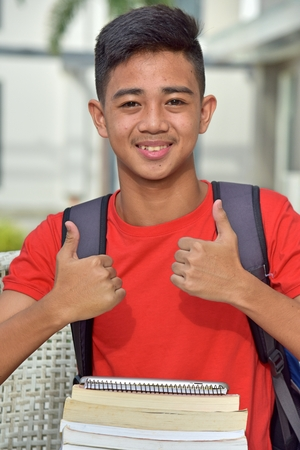 Asian Male Student With Thumbs Up
