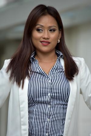Watchful Business Woman Wearing Suit 免版税图像