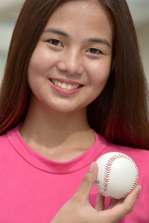 Smiling Sporty Minority Female Baseball Player Stockfoto