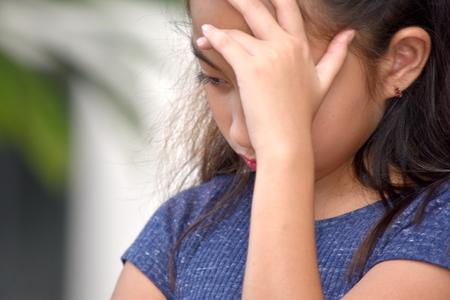 Unhappy Filipina Female Adolescent