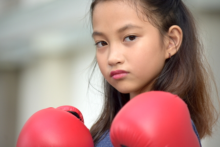 Unemotional Athlete Person Wearing Boxing Gloves Stock Photo