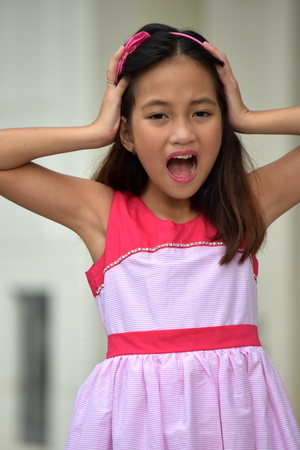 Shocked Cute Filipina Girl Child Stock Photo - 113607443