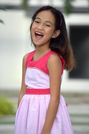 Youthful Filipina Female Laughing