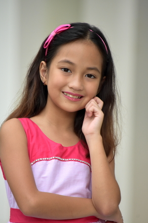 Portrait Of A Youthful Filipina Person Stock Photo