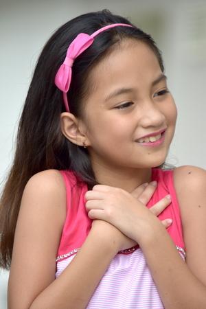 Appreciative Filipina Female Stock Photo