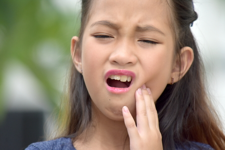 Asian Female With Toothache Stockfoto