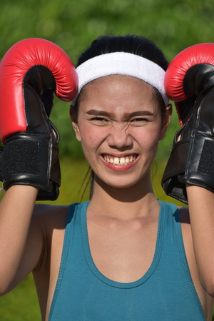 Sporty Asian Female Boxer And Anxiety