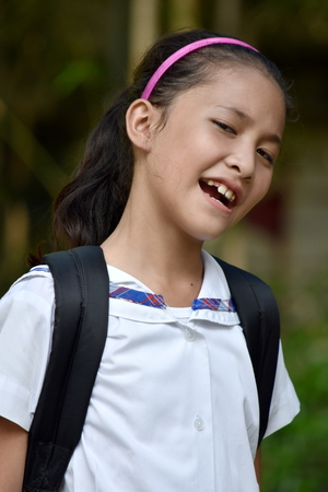 Happy Female Student School Girl Wearing School Uniform With Notebooks Stockfoto