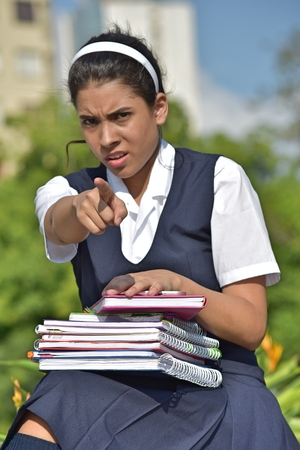 Angry Catholic Colombian Female Student With Notebooks