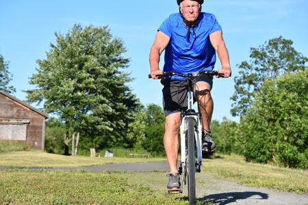 Unemotional Male Cyclist Riding Bike Stock Photo